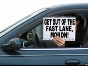 "Diver holding sign ""Get our of the fast lane, moron"""
